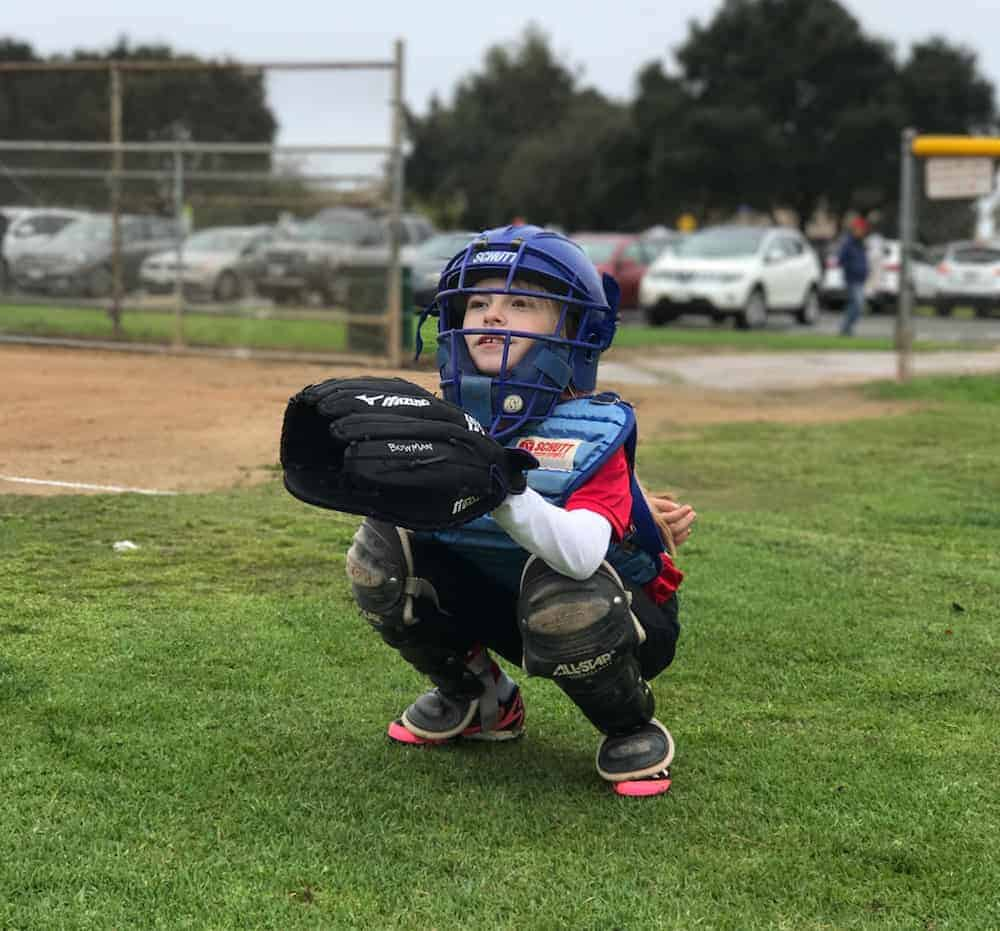Our daughter in her second year of softball, playing catcher.