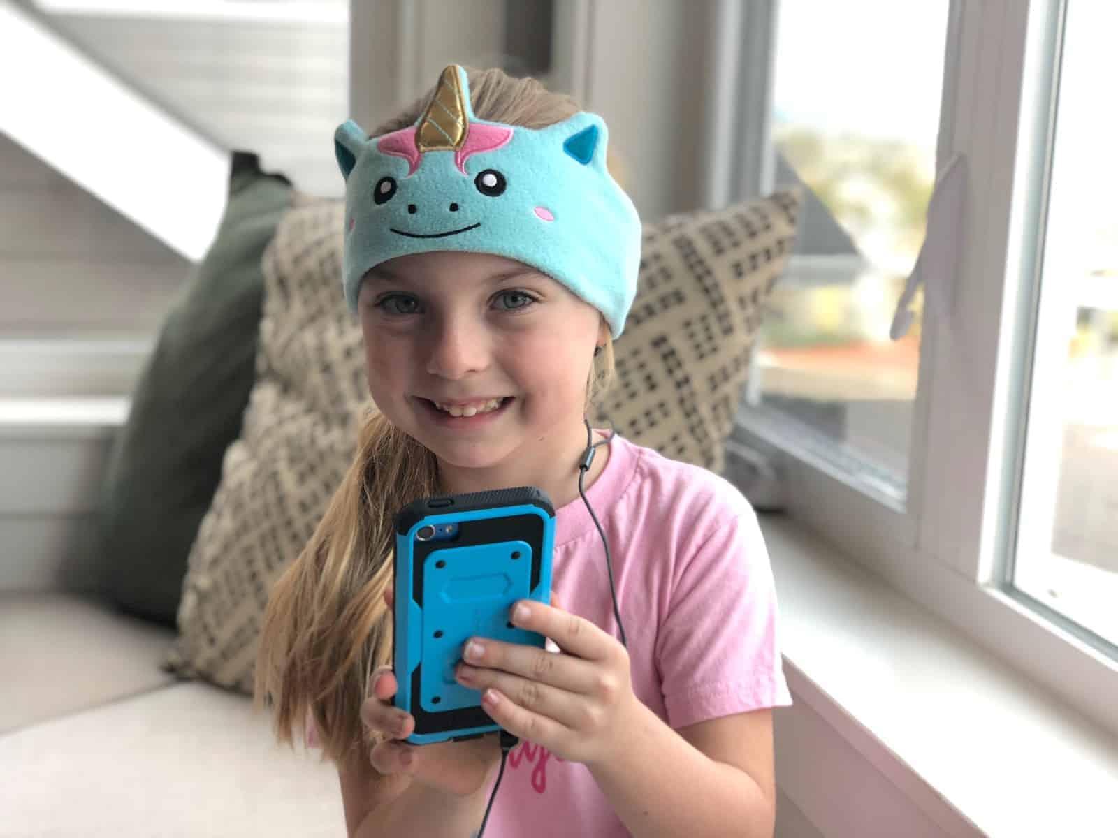 Addie is wearing her CozyPhones headband headphones!
