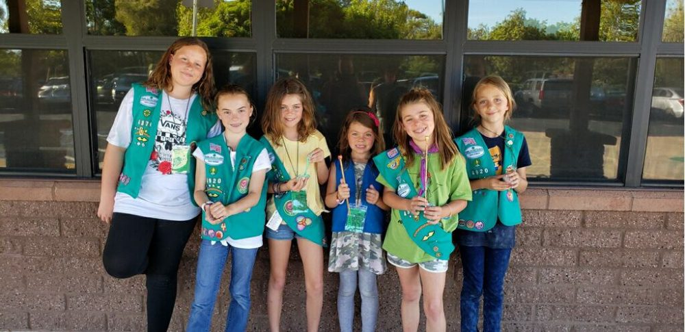 Girl Scouts make wands at a Harry Potter event