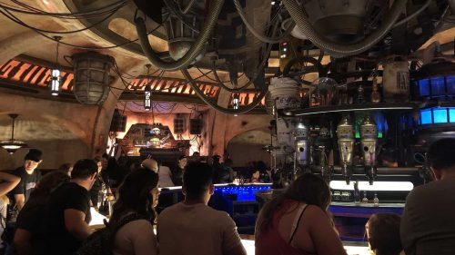 Interior photo of Oga's Cantina showing patrons sitting at the bar