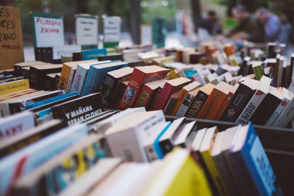 Books for sale at a yard sale.