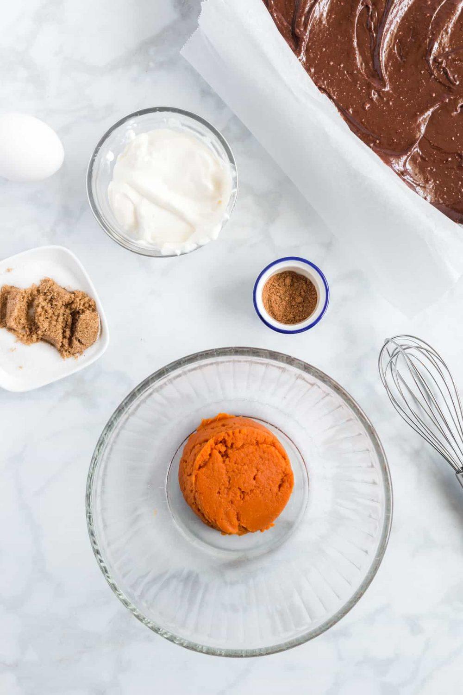 Ingredients for pumpkin cheesecake brownies
