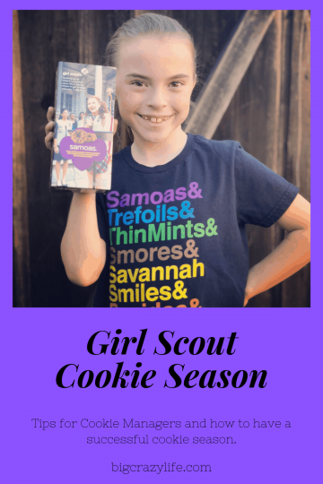 Girl Scout holding cookie box