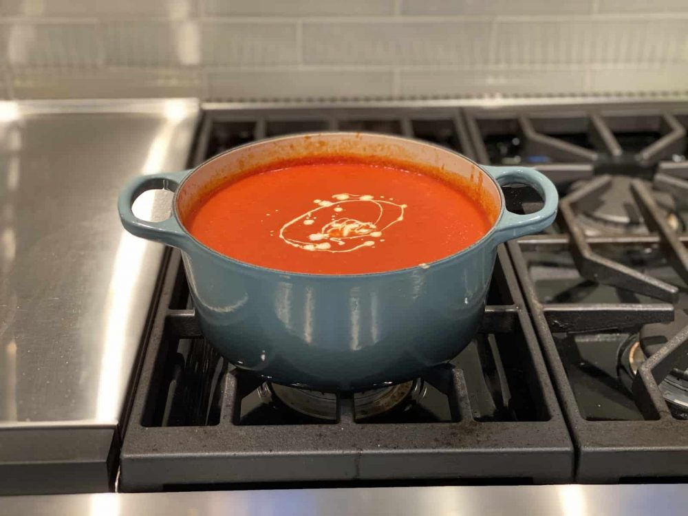 adding heavy cream to soup