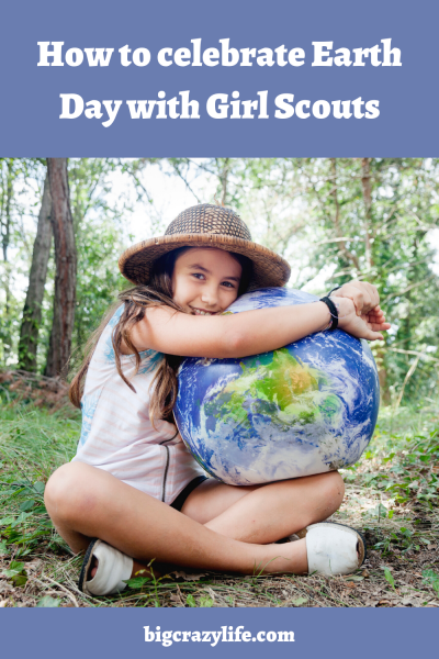 Girl holding earth ball